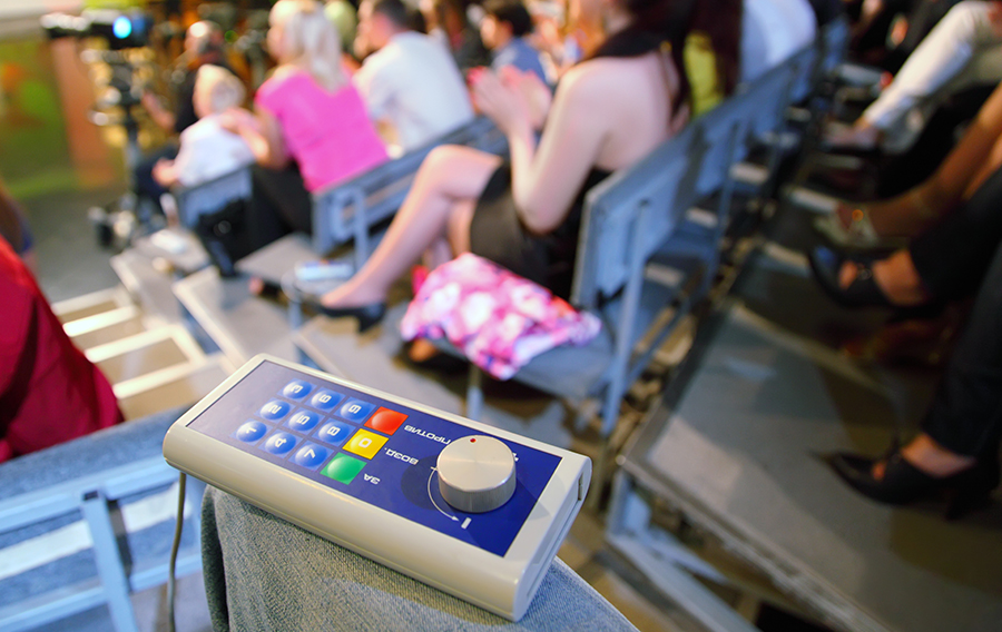 An old school clicker audience response system. There is no social aspect to this. It's Pavlovian.