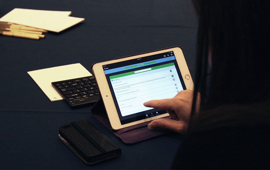 An attendee upvotes quetions that other attendees ask on her iPad. This ensures the most relevant questions will get answered by speakers first.