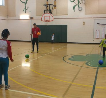 CadmiumCD Project Manager, George Heitzmann, volunteering for after school elementary basketball
